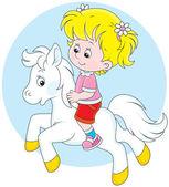 Girl riding a small white pony