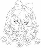 Little chickens in an Easter basket decorated with a bow and flowers
