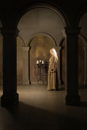 Photo for Young novice nun praying in a medieval church - Royalty Free Image