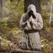 Medieval monk praying in the misty forest...