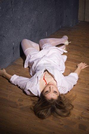 Dead nurse lying on the floor