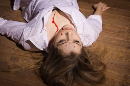 Photo for Crime scene. Dead nurse lying on the floor - Royalty Free Image