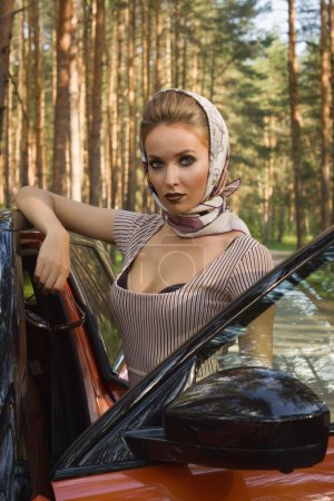 Photo for Fashion vintage woman standing near vehicle with opened door - Royalty Free Image