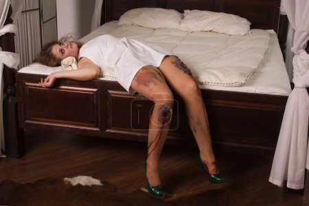 Dead woman lying on the bed