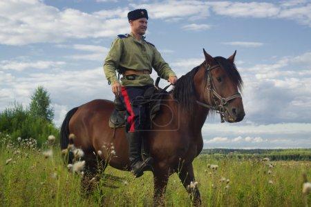 Russian Cossack inspecting the border on horseback