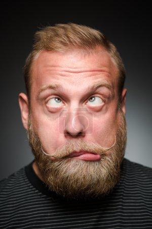 Fooling bearded man