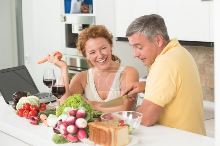 Mature couple in the kitchen