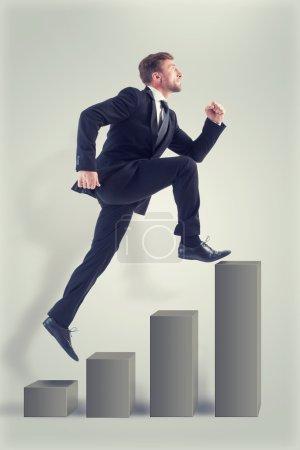 Businessman running up profitable diagram