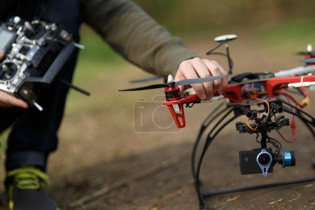 Closeup of man hand fixing propeller drone