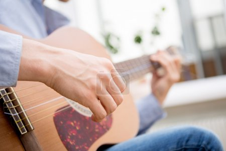 Photo for Man playing classic, acoustic guitar - Royalty Free Image