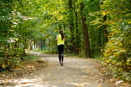 woman running at forest