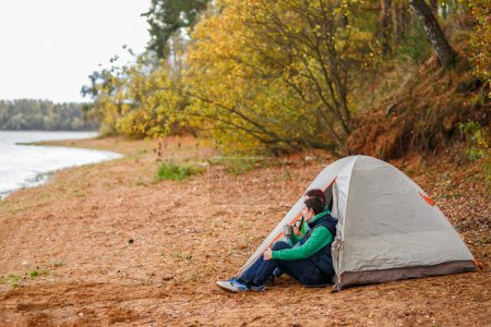 Photo for Attractive young couple camping trip in forest - Royalty Free Image