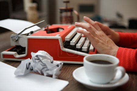 Photo for Side view of red typewriter, cup of coffe, crumpled paper - Royalty Free Image
