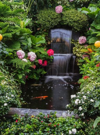 Photo for Butchart Garden Park on Vancouver Island, Canada. Gorgeous three-stage fountain surrounded by flowers - Royalty Free Image