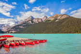 Lake Louise  is surrounded by mountains, glaciers and pine forests