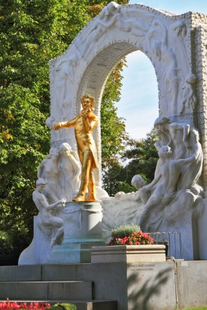 Photo for Elegant gilded statue of Johann Strauss, playing the violin in white marble arch - Royalty Free Image
