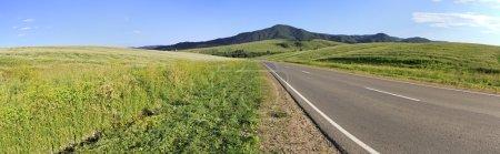 Beautiful panorama the road among farm fields.