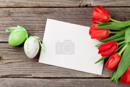 Easter eggs, tulips and greeting card