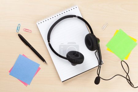 Office desk with headset and supplies