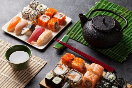 Set of sushi and maki rolls and green tea