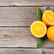 Fresh oranges on wooden table. Top view with copy ...
