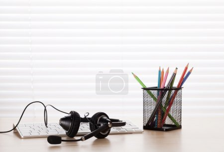 Office desk with headset and pc