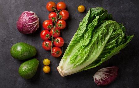 Fresh vegetables over stone table