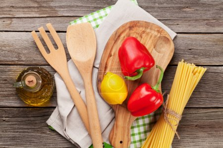 Photo for Cooking utensils and ingredients on wooden table. Top view - Royalty Free Image