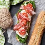 Ciabatta sandwich with romaine salad, prosciutto a...