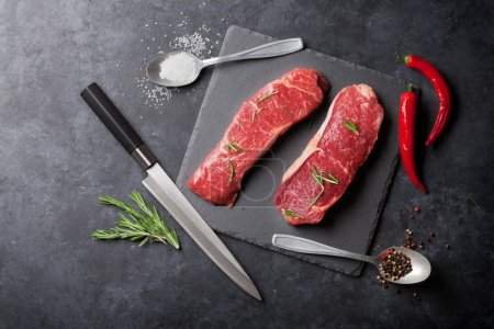 Raw striploin steaks