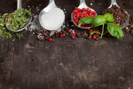 Photo for Herbs, condiments and spices on wooden background. Top view with copy space - Royalty Free Image