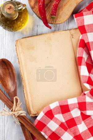 Photo for Kitchen table with cookbook, utensils and ingredients. Top view with copy space - Royalty Free Image