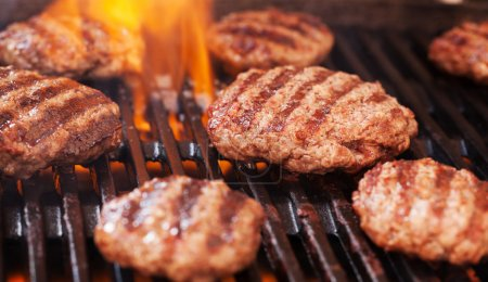 Burgers cooking on grill