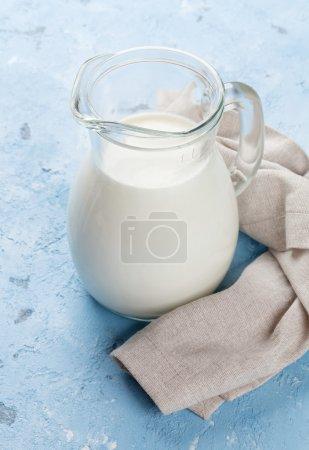 Milk jug on stone table.