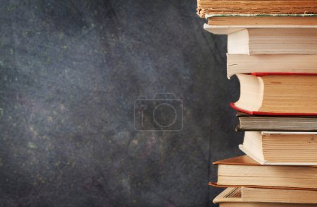 Books in front of chalk board