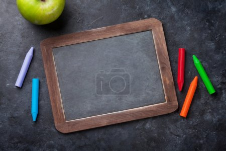 Chalkboard and colorful chalks
