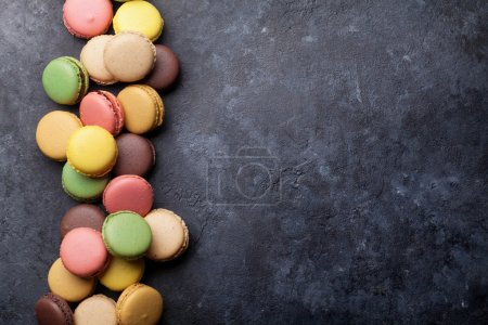 Colorful macaroons on stone table