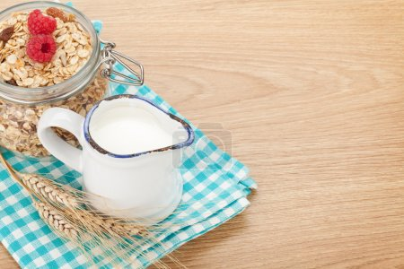 Breakfast with muesli, berries and milk