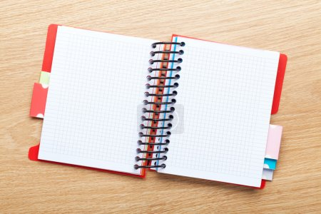 Office table with blank notepad