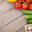 Fresh ripe vegetables on wooden table with copy sp...