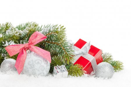 Foto de Christmas colorful decor, gift box and snow fir tree. Isolated on white background with copy space - Imagen libre de derechos