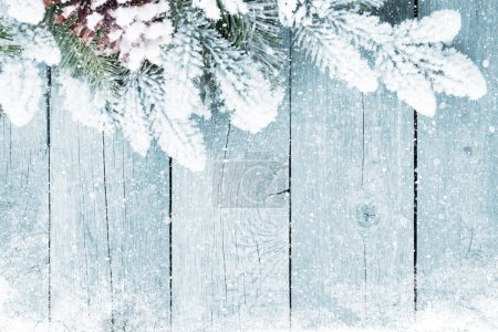 Old wood texture with snow and firtree