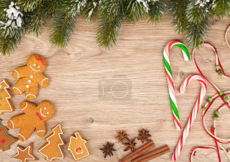 Photo for Christmas fir tree and gingerbread cookies on wooden board - Royalty Free Image
