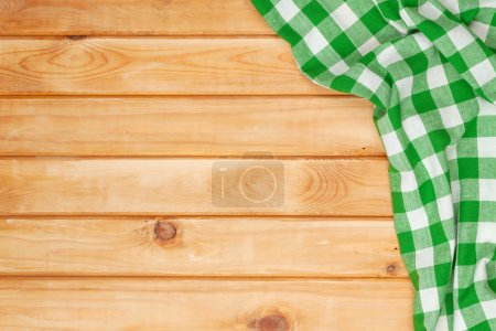 Green towel over wooden kitchen table
