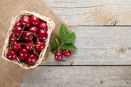 Photo for Ripe cherries on wooden table. View from above with copy space - Royalty Free Image