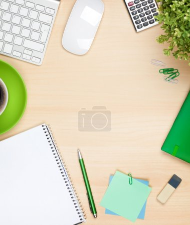 Photo pour Office table with coffee cup, computer and flower. View from above with copy space - image libre de droit