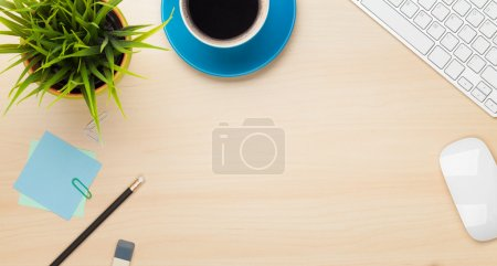 Photo for Office table with coffee cup, computer and flower. View from above with copy space - Royalty Free Image