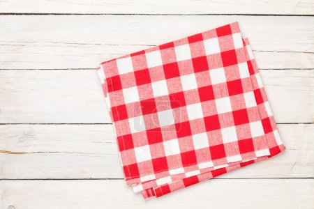 Photo for Red towel over wooden kitchen table. View from above with copy space - Royalty Free Image