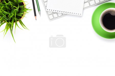 Photo for Office desk table with computer, supplies, coffee cup and flower. Isolated on white background. Top view with copy space - Royalty Free Image