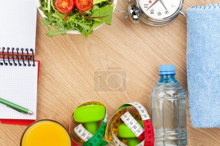 Photo for Healthy food, dumbells, tape measure and notepad for copy space. Fitness and health - Royalty Free Image